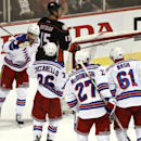 New York Rangers center Derick Brassard, left, celebrates as teammate Rick Nash, right, Ryan McDonagh, center, and Mats Zuccarello join the celebration after Brassard's goal against the Anaheim Ducks during the third period of an NHL hockey game Wednesday