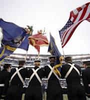 A Navy honor guard marches onto the field before an NCAA college football game against Army, Saturday, Dec. 14, 2013, in Philadelphia. (AP Photo/Matt Slocum)