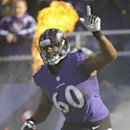 In this Nov. 10, 2013 file photo, Baltimore Ravens tackle Eugene Monroe waves as he introduced before an NFL football game against the Cincinnati Bengals, in Baltimore. With a new five-year contract, Monroe provides the Ravens with the kind of stability a