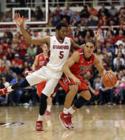 Arizona guard Nick Johnson, right, dribbles next to Stanford guard Chasson Randle (5) during the first half of an NCAA college basketball game on Wednesday, Jan. 29, 2014, in Stanford, Calif. (AP Photo/Marcio Jose Sanchez)