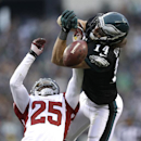 Philadelphia Eagles' Riley Cooper, right, is unable to catch a pass as Arizona Cardinals' Jerraud Powers defends during the second half of an NFL football game, Sunday, Dec. 1, 2013, in Philadelphia The Associated Press