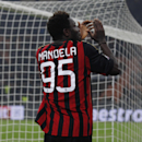 AC Milan's Sulley Muntari wears a jersey reading Mandela as he applauds supporters at the end of a Champions League, Group H, soccer match between AC Milan and Ajax at the San Siro stadium, in Milan, Italy, Wednesday, Dec.11, 2013. AC Milan is through to