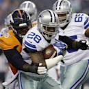 Denver Broncos defensive tackle Marvin Austin (76) wraps up Dallas Cowboys' Phillip Tanner (28) after a short run by Tanner in the first half of a NFL preseason football game, Thursday, Aug. 28. 2014, in Arlington, Texas. (AP Photo/LM Otero)