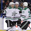 Dallas Stars forward Nicolas Blanchard (55) celebrates with defenseman Sergei Gonchar (55), of Russia, and right wing Brett Ritchie (25) after scoring against the Tampa Bay Lightning during the first period of an NHL preseason hockey game Friday, Sept. 26