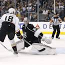 Anaheim Ducks right wing Tim Jackman, left, scores a goal past Los Angeles Kings goalie Martin Jones, right, during the first period of an NHL hockey game in Los Angeles, Saturday, March 15, 2014. (AP Photo/Danny Moloshok)