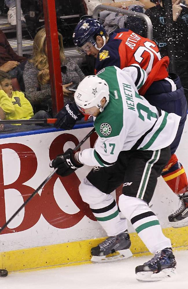 Dallas Stars defenseman Patrik Nemeth (37) and Florida Panthers right wing Bobby Butler (26) collide as they go for the puck during the first period of an NHL hockey game in Sunrise, Fla., Sunday, April 6, 2014