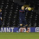 U.S. national soccer team goalkeepers Brad Guzan, right, and Nick Rimando take part in a training session at Fulham's Craven Cottage stadium in London, Thursday, Nov. 13, 2014. The U.S. are due to play Colombia in an international friendly soccer match a