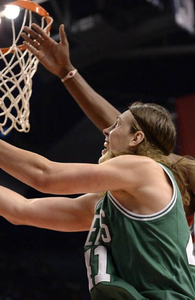 Toronto Raptors' Rudy Gay, right, defends as Boston Celtics' Kelly Olynyk shoots during the first half of an NBA preseason basketball game in Toronto on Wednesday, Oct. 16, 2013