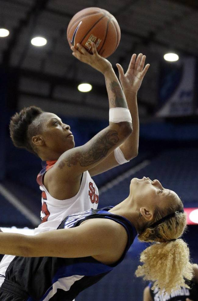 St. John's guard Danaejah Grant, left, shoots against Seton Hall forward Sidney Cook during the second half of an NCAA college basketball game in the quarterfinals of the Big East women's basketball tournament in Rosemont, Ill., Sunday, March 9, 2014