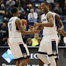 Connecticut's Rodney Purvis right, celebrates with teammate Ryan Boatright, left, during the second half of an NCAA college basketball game, Sunday, March 1, 2015, in Hartford, Conn. UConn won 81-73. (AP Photo/Jessica Hill)