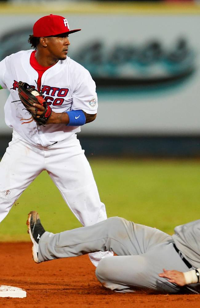 Venezuela's catcher Ramon Hernandez is tagged out at second base by Puerto Rico's infielder Iving Falu during a Caribbean Series baseball game in Porlamar, Venezuela, Wednesday, Feb. 5, 2014