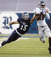 Florida Atlantic wide receiver William Dukes (19) catches a pass as Rice cornerback Phillip Gaines (15) defends during the first quarter of an NCAA college football game at Rice Stadium, Saturday, Sept. 28, 2013, in Houston. (AP Photo/Houston Chronicle, Smiley N. Pool)