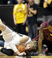 Wichita State's Ron Baker (31) dives for a loose ball with Loyola's Jeff White (23) in the first half of an NCAA college basketball game on Tuesday, Jan. 28, 2014, in Wichita, Kan. (AP Photo/The Wichita Eagle, Jaime Green)