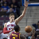 Detroit Pistons forward Jonas Jerebko (33), of Sweden, causes Cleveland Cavaliers guard Dion Waiters (3) to lose the ball while going to the basket during the first period of an NBA basketball game Wednesday, March 26, 2014, in Auburn Hills, Mich The Asso
