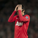 Manchester United's Shinji Kagawa holds his head during his team's English Premier League soccer match against Everton at Old Trafford Stadium, Manchester, England, Wednesday Dec. 4, 2013. (AP Photo/Jon Super)
