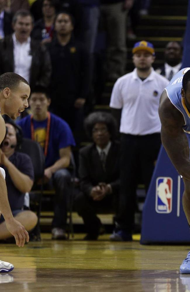 Denver Nuggets' J.J. Hickson, right, steals the ball from Golden State Warriors' Stephen Curry during the final seconds of an NBA basketball game on Wednesday, Jan. 15, 2014, in Oakland, Calif