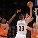 New York Knicks guard Tim Hardaway Jr. (5) and New York Knicks forward Andrea Bargnani (77) of Italy defend as New Orleans Pelicans forward Ryan Anderson (33) takes goes for two points in the second half of their NBA basketball game at Madison Square Gard