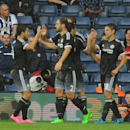 Chelsea players celebrate after Chelsea's Cesar Azpilicueta, right, scored against West Brom during the English Premier League soccer match between West Bromwich Albion and Chelsea at the Hawthorns, West Bromwich, England, Sunday, Aug. 23, 2015. (AP Photo