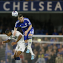 Chelsea's Gary Cahill, right jumps for the ball with Bolton's Jermaine Beckford during the English League Cup soccer match between Chelsea and Bolton Wanderers at Stamford Bridge Stadium in London, Wednesday, Sept. 24, 2014.