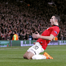Manchester United's Robin van Persie celebrates scoring his side's third goal and his hat-trick, during the Champions League, Round of 16, second leg match against Olympiakos, at Old Trafford, Manchester, England, Wednesday March 19, 2014. (AP Photo /PA,