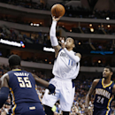 Dallas Mavericks shooting guard Monta Ellis (11) shoots the ball against Indiana Pacers' Roy Hibbert (55) and Paul George (24) during the first half of an NBA game, Sunday, March 9, 2014, in Dallas, Texas The Associated Press