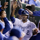 Kansas City Royals' Alcides Escobar celebrates in the dugout after scoring on a single by Alex Gordon during the sixth inning of the second game in a baseball doubleheader against the Tampa Bay Rays on Tuesday, July 7, 2015, in Kansas City, Mo. (AP Photo/Charlie Riedel)