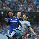 Manchester City's David Silva, right, collides with Chelsea's Willian leading to an injury for the latter, during their English Premier League soccer match at the Etihad Stadium, Manchester, England, Sunday Sept. 21, 2014
