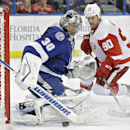 Tampa Bay Lightning goalie Ben Bishop (30) makes a save on a shot by Detroit Red Wings center Stephen Weiss (90) during the third period of an NHL hockey game Thursday, Jan. 29, 2015, in Tampa, Fla. The Lightning won the game 5-1 The Associated Press