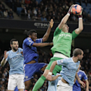 Manchester City's goalkeeper Costel Pantilimon reaches up to catch the ball as Chelsea's Mikel, second left, challenges during their English FA Cup fifth round soccer match at the Etihad Stadium, Manchester, England, Saturday, Feb. 15, 2014