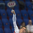 Canada's Milos Raonic serves a ball to US tennis player Steve Johnson during their first round match at the Swiss Indoors tennis tournament at the St. Jakobshalle in Basel, Switzerland, on Tuesday, Oct. 21, 2014. (AP Photo/Keystone,Georgios Kefalas)