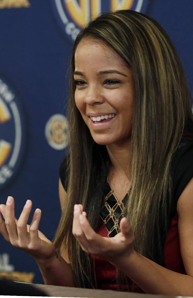 Vanderbilt player Jasmine Lister talks with reporters at the Southeastern Conference NCAA college basketball media day in Birmingham, Ala., Wednesday, Oct. 16, 2013