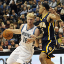 In this Nov. 9, 2012 file photo, Minnesota Timberwolves' Chase Budinger, left, drives around Indiana Pacers' Gerald Green in the second half of an NBA basketball game in Minneapolis. Budinger has undergone arthroscopic surgery on his left knee and is out
