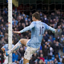 Manchester City's Edin Dzeko kicks the goal post after missing a shot from close range during his team's English Premier League soccer match against Stoke at the Etihad Stadium, Manchester, England, Saturday Feb. 22, 2014