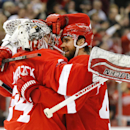 Detroit Red Wings left wing Henrik Zetterberg, right, congratulates goalie Petr Mrazek (34) after beating the Minnesota Wild in a shootout during an NHL hockey game in Detroit Tuesday, Jan. 20, 2015 The Associated Press