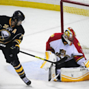 Buffalo Sabres left winger Matt Moulson (26) deflects the puck as Florida Panthers goaltender Roberto Luongo (1) makes a glove-save during the third period of an NHL hockey game Friday, Oct., 17, 2014, in Buffalo, N.Y. Florida won 1-0 The Associated Press