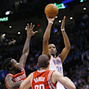 Oklahoma City Thunder forward Kevin Durant (35) shoots over Houston Rockets guard Pat Beverley (2) and guard Francisco Garcia (32) during the fourth quarter of an NBA basketball game in Oklahoma City, Tuesday, March 11, 2014. Durant scored 42 points as Ok