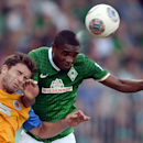In this picture taken Saturday Aug. 10, 2013, Braunschweig's Ken Reichel. left, and Bremen's Cedrick Makiadi vie for the ball during the Bundesliga soccer match between Eintracht Braunschweig and SV Werder Bremen in Braunschweig, Germany. Back in the Bundesliga after a 28-year-absence, Eintracht Braunschweig isn't losing heart despite its bittersweet return to the top-flight. Braunschweig lost 1-0 at home after conceding a late goal to Werder Bremen on Saturday. (AP Photo/dpa,Peter Steffen)