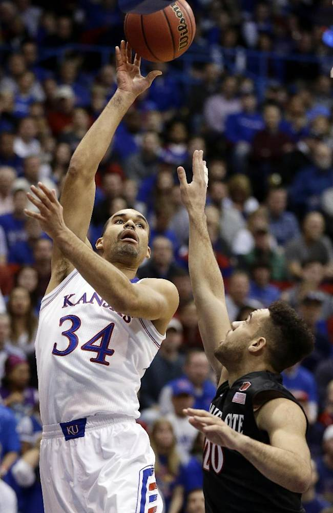 Kansas' Perry Ellis (34) shoots over San Diego State's JJ O'Brien (20) during the first half of an NCAA college basketball game Sunday, Jan. 5, 2014, in Lawrence, Kan