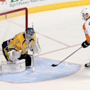 Philadelphia Flyers center Vincent Lecavalier (40) scores against Nashville Predators goalie Marek Mazanec (39), of the Czech Republic, during a shootout at an NHL hockey game Saturday, Nov. 30, 2013, in Nashville, Tenn. Lecavalier's was the only player t