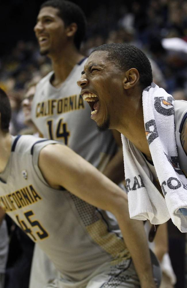 California's Richard Solomon, front, and David Kravish (45) react with teammates near the end of an NCAA college basketball game against Washington, Wednesday, Jan. 15, 2014, in Berkeley, Calif