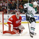 Dallas Stars right wing Erik Cole (72) tries to redirect a shot at Detroit Red Wings goalie Jimmy Howard (35) in the first period during an NHL hockey game in Detroit, Thursday, Dec. 4, 2014 The Associated Press