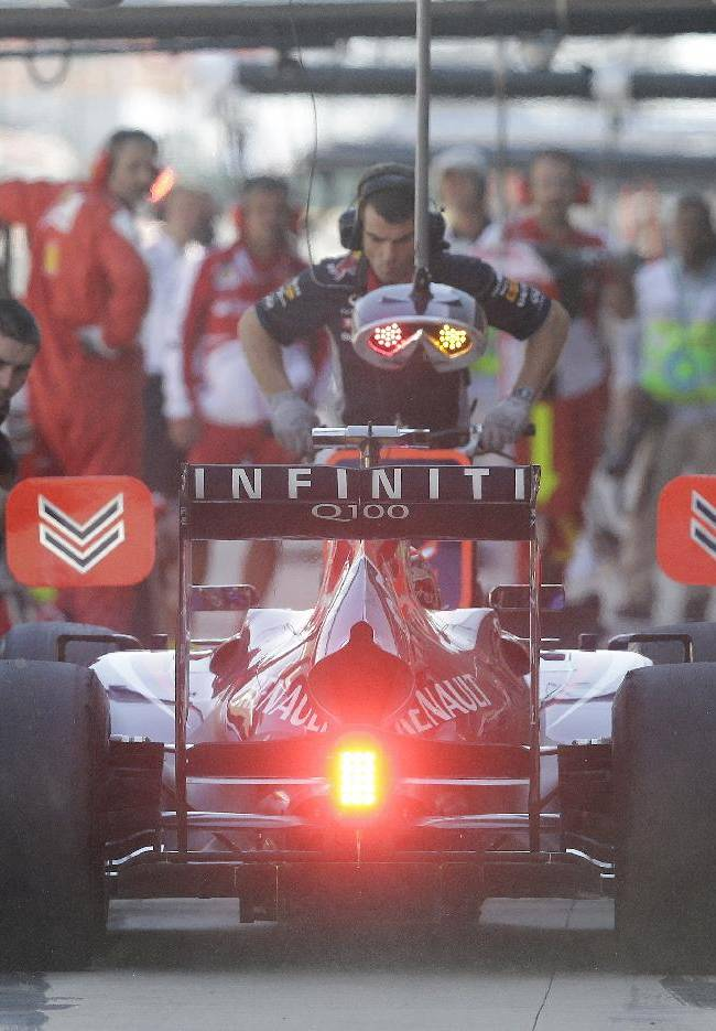 Red Bull driver Sebastian Vettel of Germany steers his car into pit lane during the first practice session for the Korean Formula One Grand Prix at the Korean International Circuit in Yeongam, South Korea, Friday, Oct. 4, 2013