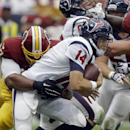 Houston Texans' Ryan Fitzpatrick (14) is sacked by Washington Redskins' Jason Hatcher (97) during the second quarter of an NFL football game Sunday, Sept. 7, 2014, in Houston The Associated Press