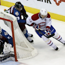 Montreal Canadiens center Tomas Plekanec, back right, of the Czech Republic, tries to wrap around the net for shot as Colorado Avalanche center Nathan MacKinnon, back left, covers with goalie Calvin Pickard in the third period of the Canadiens' 4-3 victor