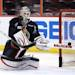 Ottawa Senators backup goaltender Robin Lehner stops the puck with his stick during practice in Ottawa, Ontario, Saturday, May 18, 2013, on the eve of Game 3 of the NHL hockey Stanley Cup playoff series against the Pittsburgh Penguins
