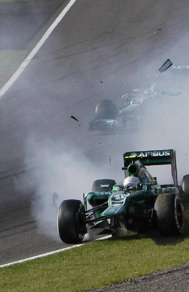 Caterham driver Giedo van der Garde of the Netherlands crashes in the first corner at the start of the Japanese Formula One Grand Prix at the Suzuka circuit in Suzuka, Japan, Sunday, Oct. 13, 2013