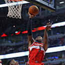 CHICAGO, IL - OCTOBER 06: Bradley Beal #3 of the Washington Wizards shoots over Jimmy Butler #21 of the Chicago Bulls during a preseason game at the United Center on October 6, 2014 in Chicago, Illinois. (Photo by Jonathan Daniel/Getty Images)