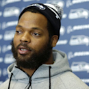 Seattle Seahawks defensive end Michael Bennett talks to reporters, Monday, March 10, 2014, at the team's headquarters in Renton, Wash. The Seahawks announced Monday that Bennett, who was one of the top NFL football free agents this year, had signed a mult