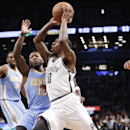 Brooklyn Nets guard Tyshawn Taylor (10) drives past Denver Nuggets point guard Nate Robinson in the first half of an NBA basketball game Tuesday, Dec. 3, 2013, in New York The Associated Press