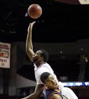 Texas A&M's Antwan Space, top, goes up for a shot over Auburn's Allen Payne during the first half of an NCAA college basketball game Saturday, March 8, 2014, in College Station, Texas. Payne was called for a blocking foul on the play. (AP Photo/David J. Phillip)